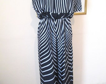 Stunning new white and black handmade Jump Suit size M  10-12 In stretch jersy fabric