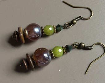 Beautiful handmade glass beaded earrings, accented with shell disc bead, chartreuse agate bead and bronze findings.