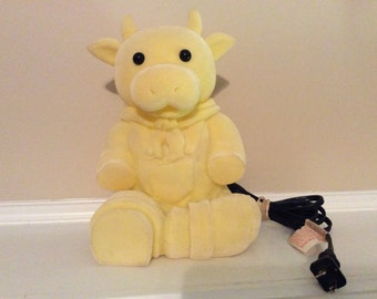 A large Yellow Cow Bull Figurine Night Light/ Portable Lamp.