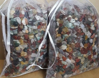 One large bag of semi precious stone chip and drilled beads.