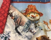 Snowman quilt kit ready to finish contains completed pieced top, backing and binding.  You just need to add batting, quilt and bind.