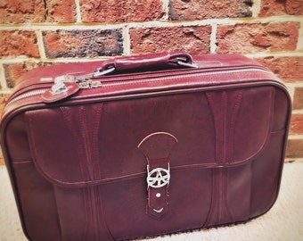 Vintage American Tourister 1970s maroon suitcase