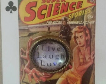 Brooch. Live laugh love . On a pulp fiction horror movie playing card.