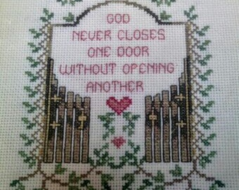 """Framed Cross Stitch Picture """"God Never Closes One Door Without Opening Another"""""""