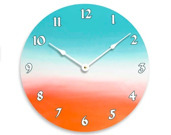 Contemporary 10 inch wall or kitchen clock. Teal, white and orange colors.CL3249