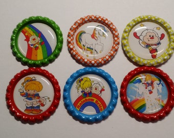 Set of 6 Rainbow Bright themed Finished Bottle Caps - Magnets - Necklaces ( You Pick )