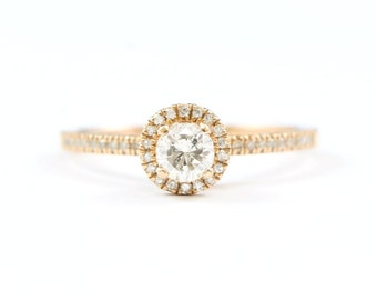 Rose gold diamond solitaire halo engagement ring in 10 carat gold handmade