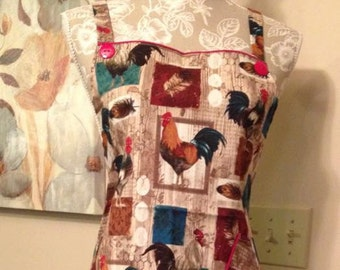 """a """"Country Rooster"""" full apron with pocket and skirt. Red cord trim on skirt and pocket. SML, monogram extra"""