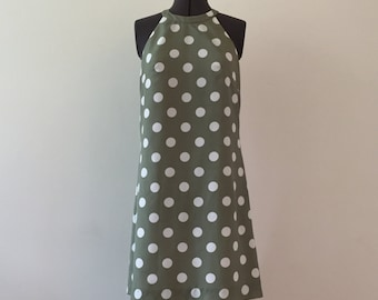 Green halter dress with white polka dots