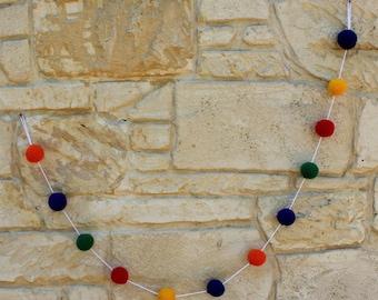Garland: hand crocheted ball garland in red, blue, yellow, purple, orange and green yarn