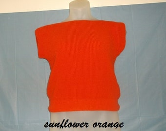 Machine knit shell sweater with a cap sleeve. Bodice is a tuck stitch. Resembles a honeycomb My shell is knitted in sunflower orange.