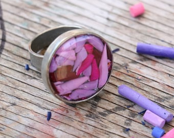 Adjustable ring pewter manufactured with recycled resin color pencils