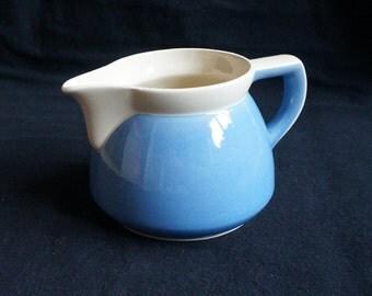 Rare vintage stoneware creamer milk pitcher (might be Waku Germany), cream coloured with light blue, very nice shape , midcentury, big model