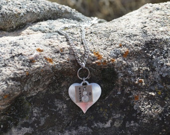 Heart and Charms pendant with long chain.