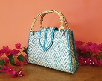 Elegant and Eco-friendly straw handbag with bamboo handles