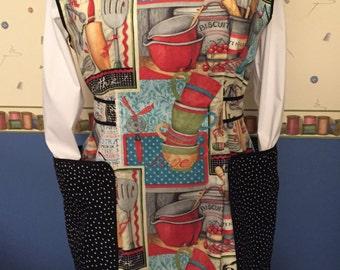 Full Coverage Cobbler Apron - Generous coverage cobbler apron done in quality 100% cotton in a red/black/multi color kitchen motif.