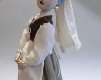 A girl with a pearl earring living doll figurine