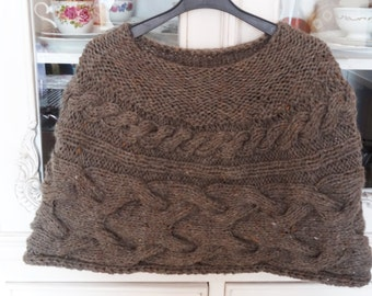 knitted, soft, dark-grey cabled poncho