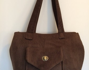 Classy brown fabric handbag with handy exterior pocket, everyday bag