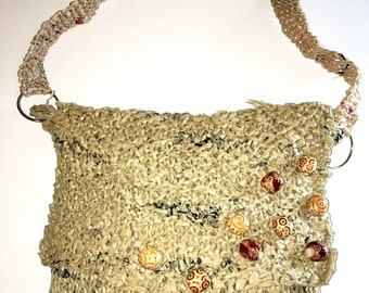 1 Tan/Brown/Black plastic purse w/ bead and silver detail Item: #16