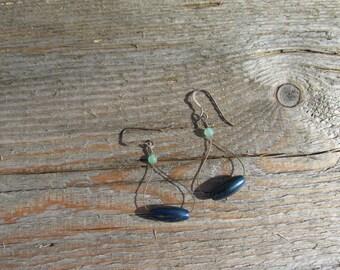 Seductive mood.  Dangle earrings