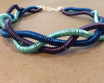 Plaited three coloured blue coiled wire choker