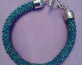 Kumihimo Bracelet with lime lined glass AB seed beads.
