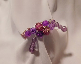 Purple and Gold Mayan Design Beaded Bracelet with Dangles