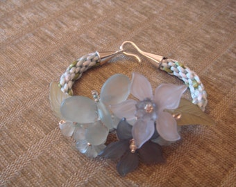 Kumihimo bracelet with lucite flowers
