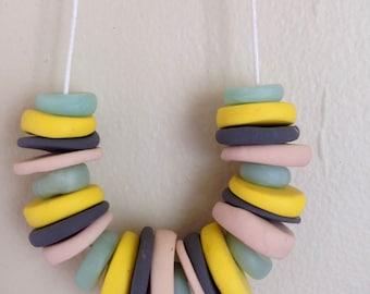 pebbles + stones necklace: sunshine