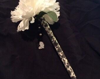 White  carnation flower pen with heart dangle