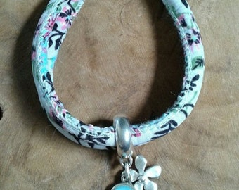 Aztec/flowers cord bracelet