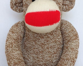 Traditional Rockford red heel sock monkey with a rainbow striped pom pom hat (Made to order)
