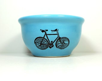 small bowl with a Dusty Road Bike print, shown on Cloudless Blue glaze, Ready to Ship.