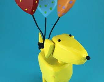 Big dog with heart balloons