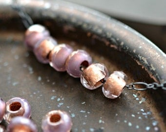 Lavender Fields - Premium Czech Glass Beads, Transparent Lavender, Metallic Copper Lined, Rollers 6x9mm - Pc10
