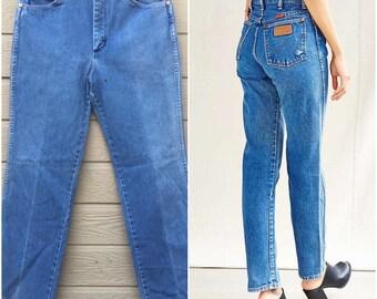 Vintage Wrangler. Wrangler. Boyfriend Jeans. Boot cut.  Vintage denim. Distressed. Medium wash. 32 x 31. Black label. Haute denim