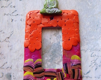 Green Floating Buddha, rocker switch plate, orange, purple, green, pink, lime and black, one of a kind, polymer clay