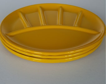Four Yellow Enamel Vintage Plates