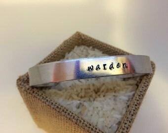 Warden (Dragon Age) hand-stamped cuff bracelet
