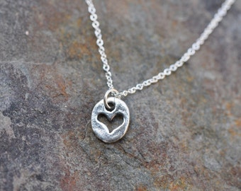 Sterling Silver cut out heart charm necklace on silver chain, dainty silver heart necklace
