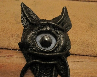 Grichels leather pin/tie tack/brooch - black with blue carousel horse eye