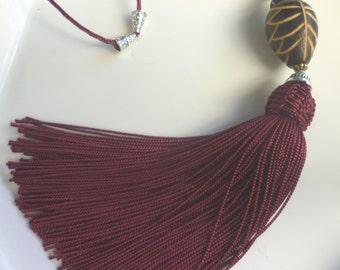 Moroccan  tribal, bead tassel necklace, deep red art silk,  wooden leaf bead