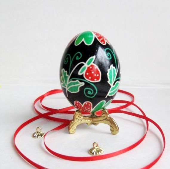 Strawberry pysanka batik egg cute berries painted on the egg shell fun way to brighten up with Easter decorations