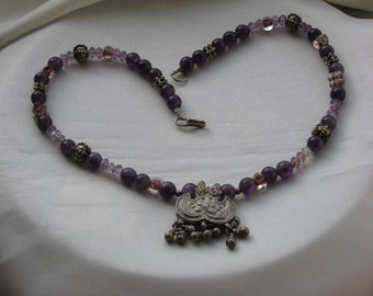 Handmade necklace made of amethyst beads, glass beads, silver beads with antique silver pendant