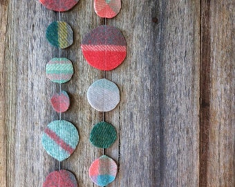 colourful wool circle garland upcycled from vintage wool blanket offcuts, handmade one of a kind