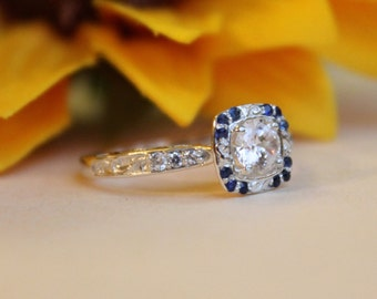 Half Carat Diamond engagement ring with Blue Sapphire accents, sapphire halo, blue halo ring