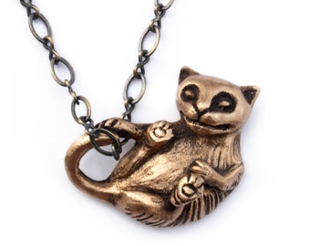 Cat necklace playing kitten