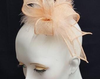 Peach sinamay fascinator with  feathers headband fixing  wedding races