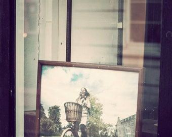 Girl on Bike. Brighton, England